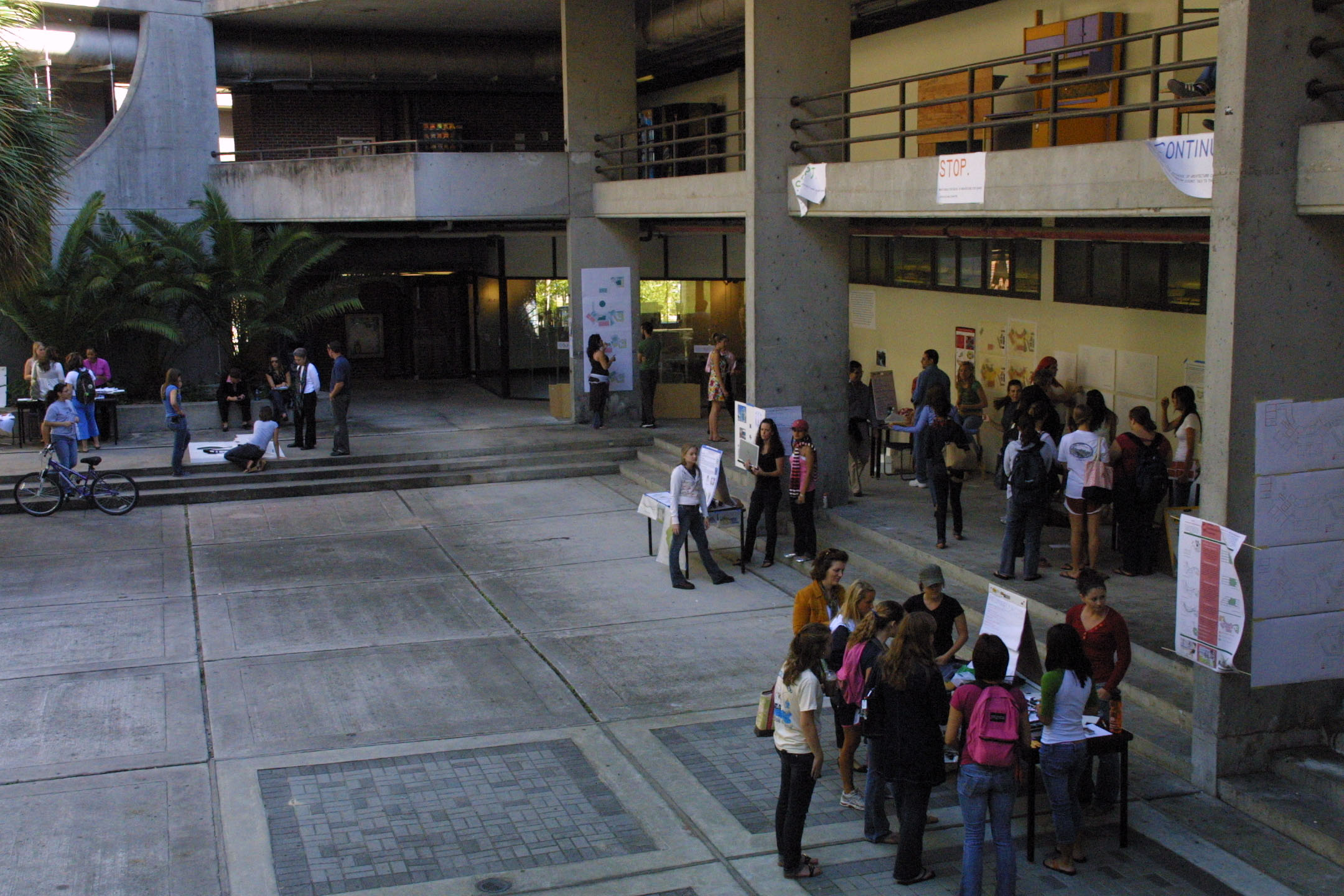 students set up presentation booths in the atrium (which some students ...